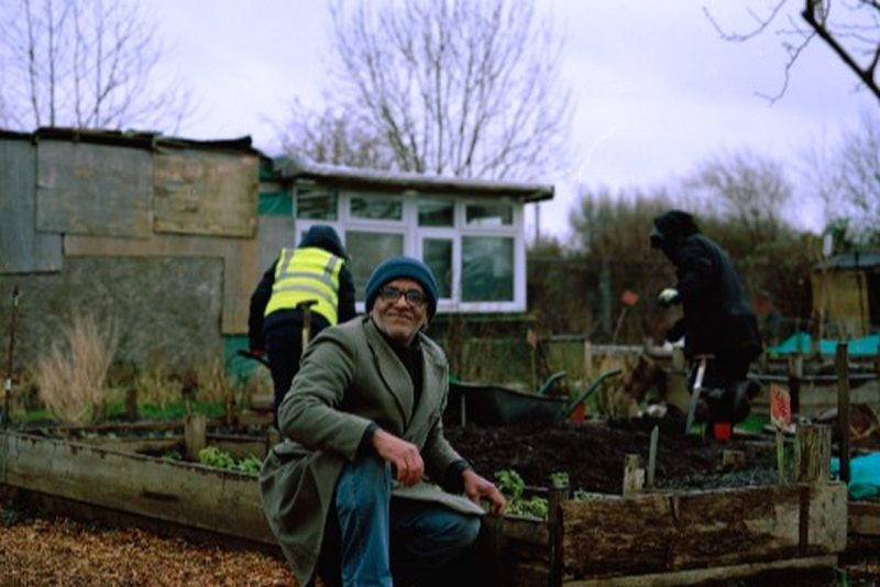 Growing Together Levenshulme man planting raised bed